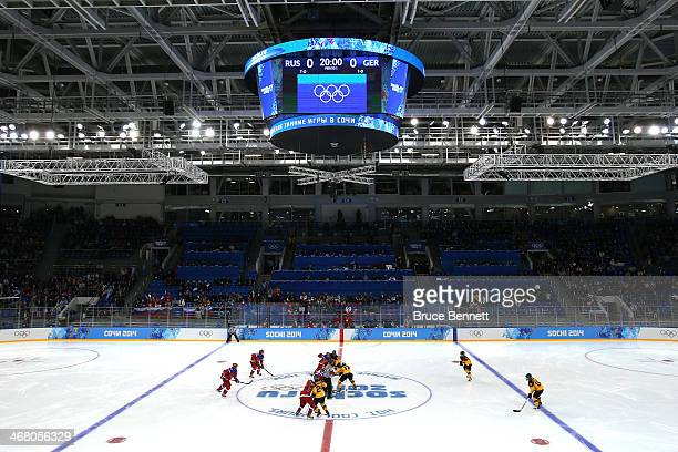 Tatyana Burina of Russia faces off against Sara Seiler of Germany during the Women's Ice Hockey Preliminary Round Group B Game on day two of the...