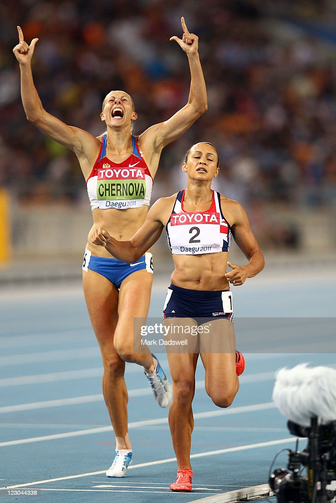 Tatyana Chernova (L) of Russia celebrates claiming gold in the women's heptathlon as Jessica Ennis of Great Britain shows her dejection during day four of the 13th IAAF World Athletics Championships at the Daegu Stadium on August 30, 2011 in Daegu, South Korea.