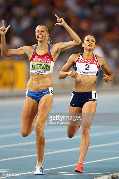 Tatyana Chernova of Russia celebrates claiming gold in the women's heptathlon as Jessica Ennis of Great Britain shows her dejection during day four...
