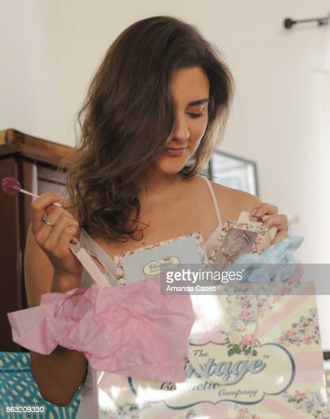Tatyana Figueiredo gets her itamins from a Zollipop whilst opening her Vintage Cosmetic Company gift bag at New Faces at TAP The Artists Project on...
