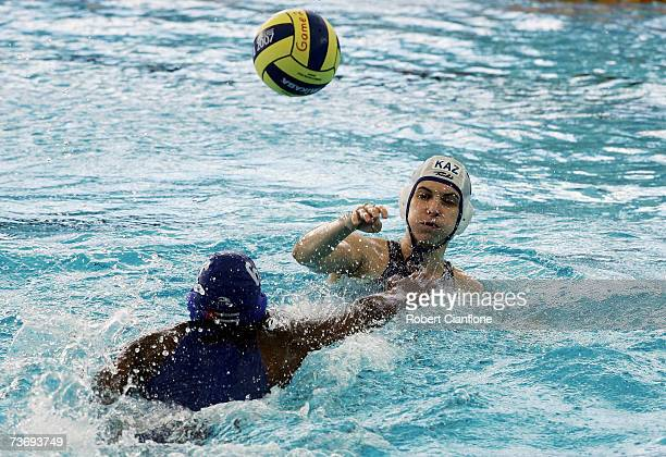 Tatyana Gubina of Kazakhstan makes a pass under pressure during the Women's Final Round Water Polo match between Kazakhstan and Cuba at the Melbourne...