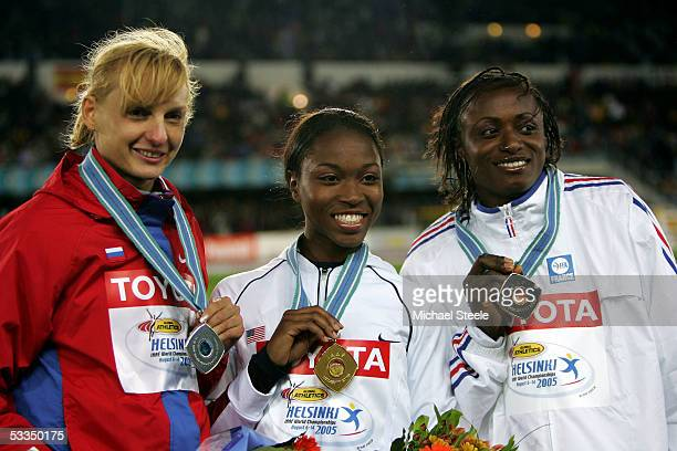 Tatyana Kotova of Russia Tianna Madison of USA and Eunice Barber of France pose for a picture during the medal ceremony for the womens 400 metres...