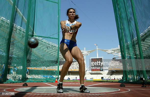 Tatyana Lysenko of Russia competes in the women's hammer throw qualifying round on August 23, 2004 during the Athens 2004 Summer Olympic Games at the...