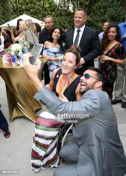 Tatyana McFadden and Ricky Martin attend GOLD MEETS GOLDEN The 5th Anniversary Refreshed by CocaCola Globes Weekend Gets Sporty with Nicole Kidman...