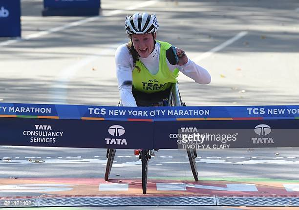 Tatyana McFadden from the US crosses the finish line to win the Women's Wheelchair division during the 2016 TCS New York City Marathon November 6...
