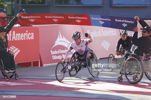 Tatyana McFadden of Champaign Illinois wins the women's wheelchair division of the Bank of America Chicago Marathon in Chicago on Sunday October 13...