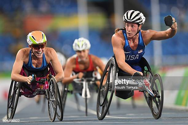 Tatyana McFadden of the United States and Amanda McGrory celebrate winning the gold and bronze medals respectively in the Women's 1500m T54 Final on...