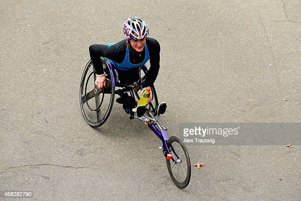 Tatyana McFadden of the United States celebrates after crossing the finish line to win the Pro Pushrim Women's division during the 2014 TCS New York...