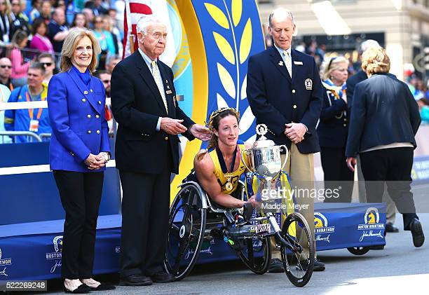 Tatyana McFadden of the United States celebrates after crossing the finish line to win the women's push rim wheelchair race during the 120th Boston...