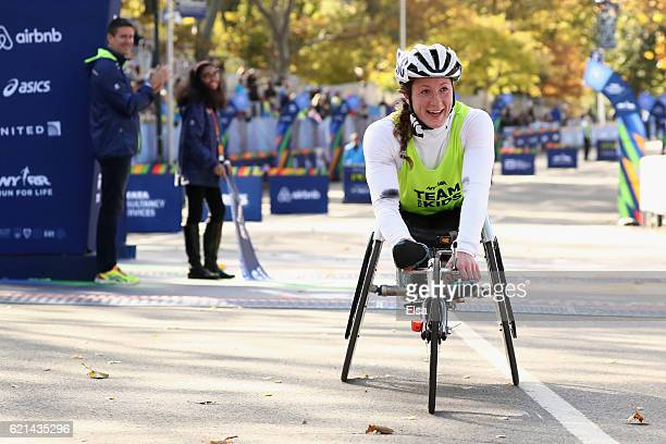 Tatyana McFadden of the United States celebrates winning the Professional Women's Wheelchair Division during the 2016 TCS New York City Marathon in...