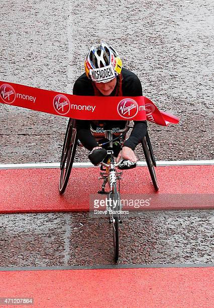 Tatyana McFadden of the United States crosses the finish line to win the Women's wheelchair Virgin Money London Marathon on April 26 2015 in London...
