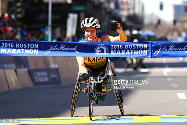 Tatyana McFadden of the United States crosses the finish line to win the women's push rim wheelchair race during the 120th Boston Marathon on April...