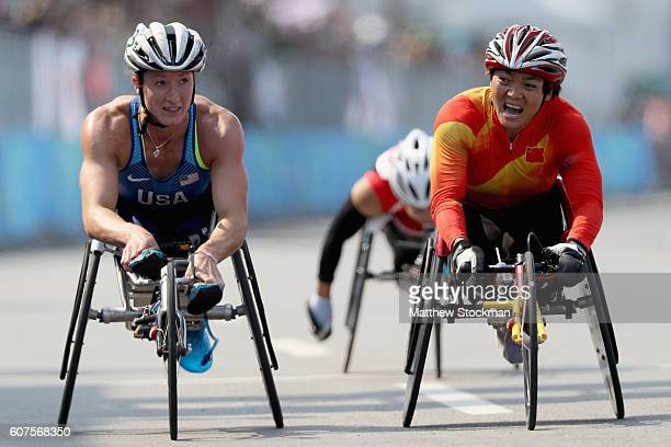 Tatyana McFadden of the United States is edged out at the finish by Lihong Zou of China in the women's marathon T54 during day 11 of the Rio 2016...