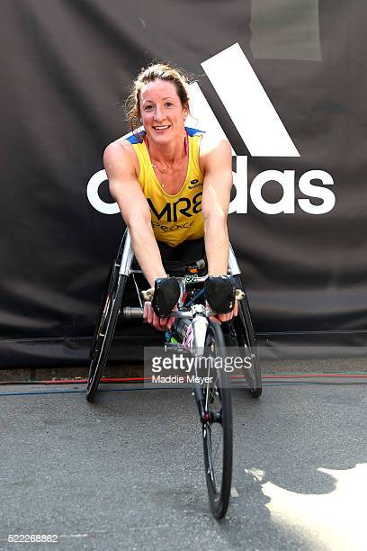 Tatyana McFadden of the United States poses after crossing the finish line to win the women's push rim wheelchair race during the 120th Boston...