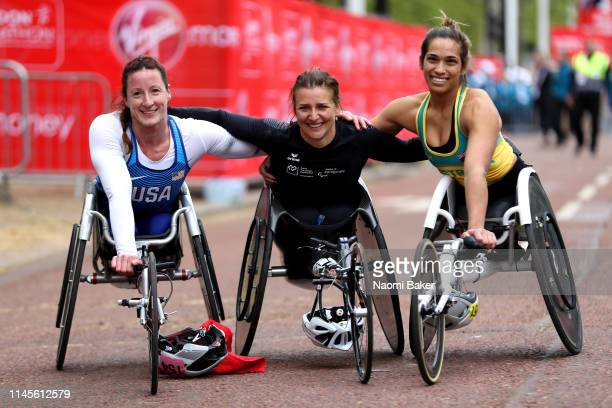 Tatyana McFadden of The USA Manuela Schar of Switzerland and Madison de Rozario of Australia all pose for a photo after competing in the Women's...