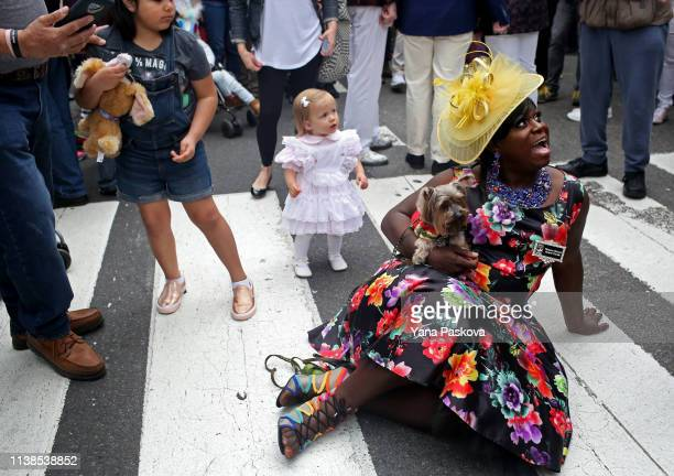 Tatyana Monet takes a rest with her Yorkie dog Fendi in Midtown East for the annual Easter Parade on April 21 2019 in New York City Each year New...