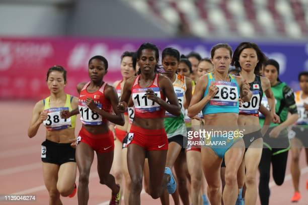 Tatyana Neroznak of Kazakhstan and Gashaw Tigest of Bahrain compete during the fourth day of the 23rd Asian Athletics Championships at Khalifa...
