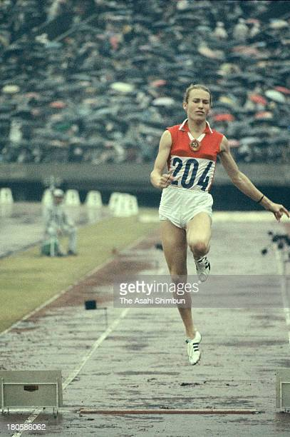 Tatyana Shchelkanova of Soviet Union competes in the Women's Long Jump qualification during the Tokyo Olympics at the National Stadium on October 14...