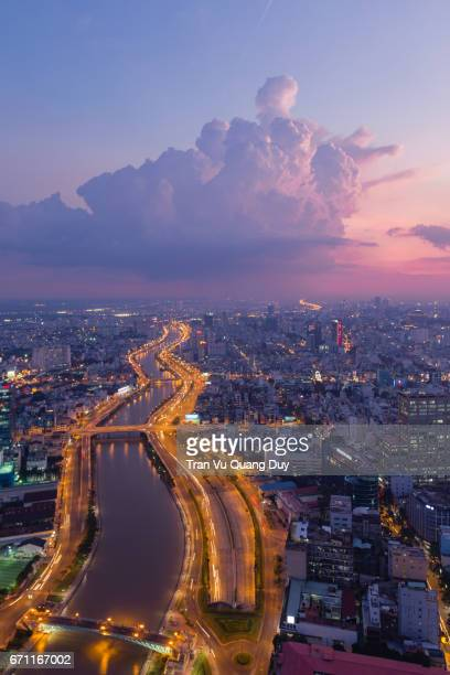tau hu canal at night, viewed from the roof of the mc building, with the blue green winding channel. - people's committee building ho chi minh city stock pictures, royalty-free photos & images