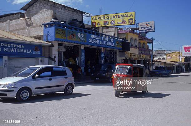tauk tauk in poptun, guatemala - auto rickshaw stock pictures, royalty-free photos & images