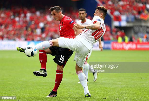 Taulant Xhaka of Albania and Granit Xhaka of Switzerland compete for the ball during the UEFA EURO 2016 Group A match between Albania and Switzerland...