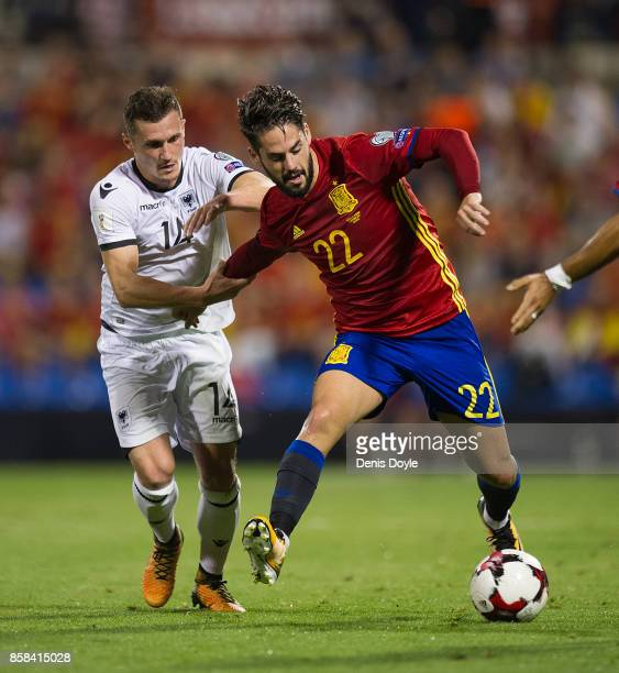 Taulant Xhaka of Albania holds Isco Alarcon of Spain during the FIFA 2018 World Cup Qualifier between Spain and Albania at Estadio Jose Rico Perez on...