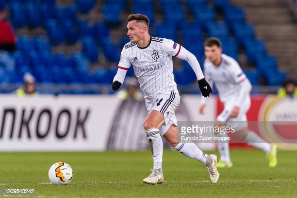 Taulant Xhaka of Basel runs with the ball during the UEFA Europa League round of 32 second leg match between FC Basel and APOEL Nikosia at St...