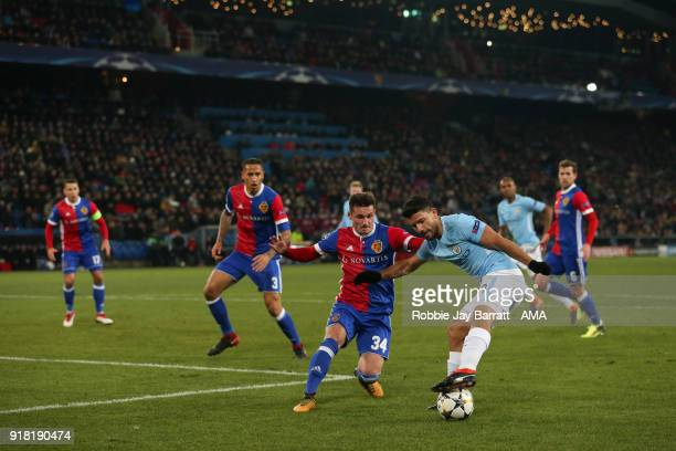 Taulant Xhaka of FC Basel and Sergio Aguero of Manchester City during the UEFA Champions League Round of 16 First Leg match between FC Basel and...