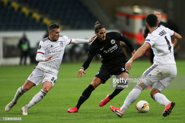 Taulant Xhaka of FC Basel Goncalo Paciencia of Eintracht Frankfurt Eray Coemert of FC Basel during the UEFA Europa League round of 16 first leg match...
