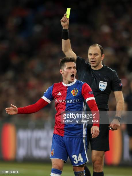 Taulant Xhaka of FC Basel reacts after receiving a yellow card during the UEFA Champions League Round of 16 First Leg match between FC Basel and...