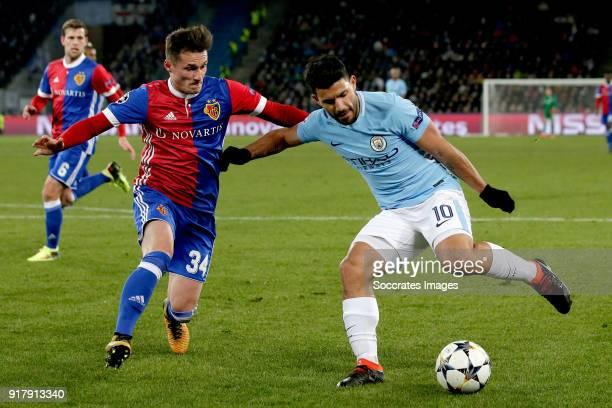Taulant Xhaka of FC Basel Sergio Aguero of Manchester City during the UEFA Champions League match between Fc Basel v Manchester City at the St...