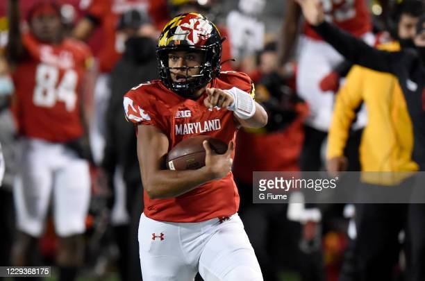 Taulia Tagovailoa of the Maryland Terrapins runs for a touchdown in the first half against the Minnesota Golden Gophers at Capital One Field at...