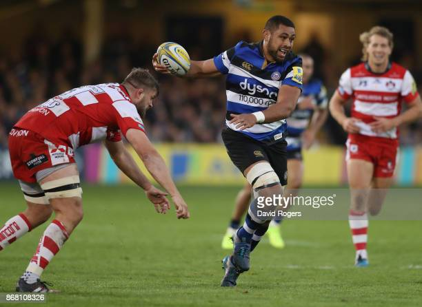 Taulupe Faletau of Bath breaks with the ball during the Aviva Premiership match between Bath Rugby and Gloucester Rugby at the Recreation Ground on...