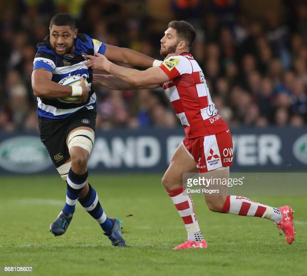 Taulupe Faletau of Bath holds off Owen Williams during the Aviva Premiership match between Bath Rugby and Gloucester Rugby at the Recreation Ground...