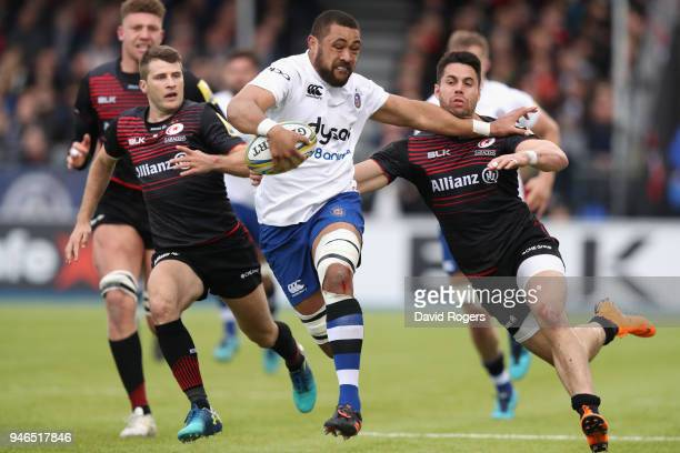 Taulupe Faletau of Bath holds off Sean Maitland during the Aviva Premiership match between Saracens and Bath Rugby at Allianz Park on April 15 2018...