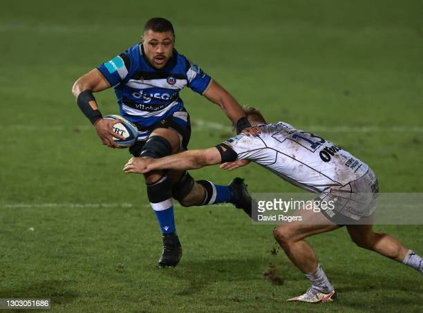Taulupe Faletau of Bath is tackled by Chris Harris of Gloucester during the Gallagher Premiership Rugby match between Bath and Gloucester at The...
