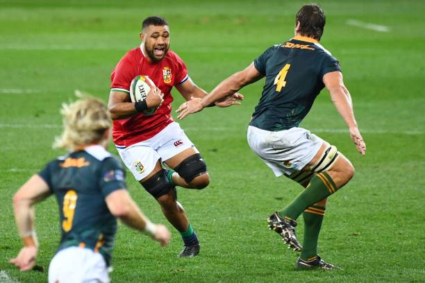 """Taulupe Faletau (C) of British & Irish Lions runs with the ball during the Rugby union match between the South Africa """"A"""" and the British and Irish Lions at Cape Town Stadium on July 14, 2021 in Cape Town. (Photo by RODGER BOSCH / AFP) (Photo by RODGER BOSCH/AFP via Getty Images)"""