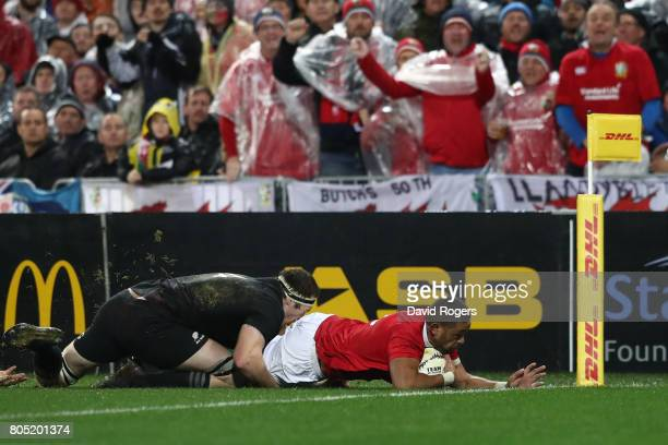 Taulupe Faletau of the Lions dives over to score the opening try during the second test match between the New Zealand All Blacks and the British...