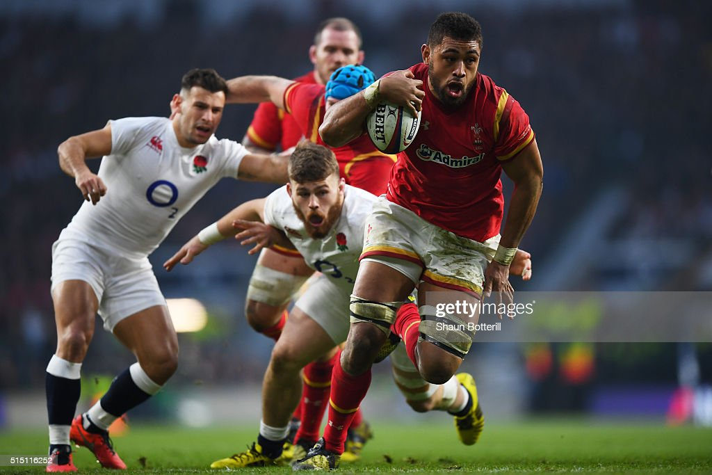 Taulupe Faletau of Wales evades a tackle from Luke Cowan-Dickie of England on the way to scoring his try during the RBS Six Nations match between England and Wales at Twickenham Stadium on March 12, 2016 in London, England.