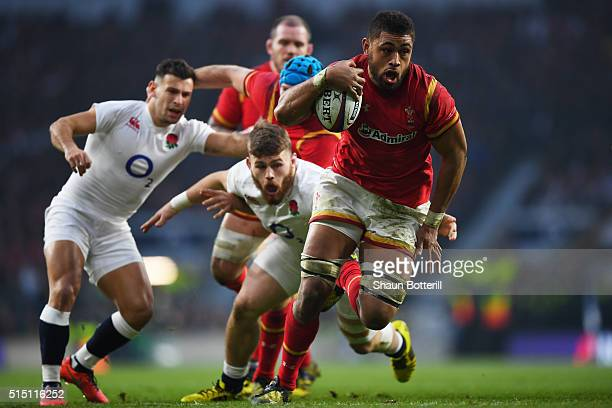 Taulupe Faletau of Wales evades a tackle from Luke CowanDickie of England on the way to scoring his try during the RBS Six Nations match between...