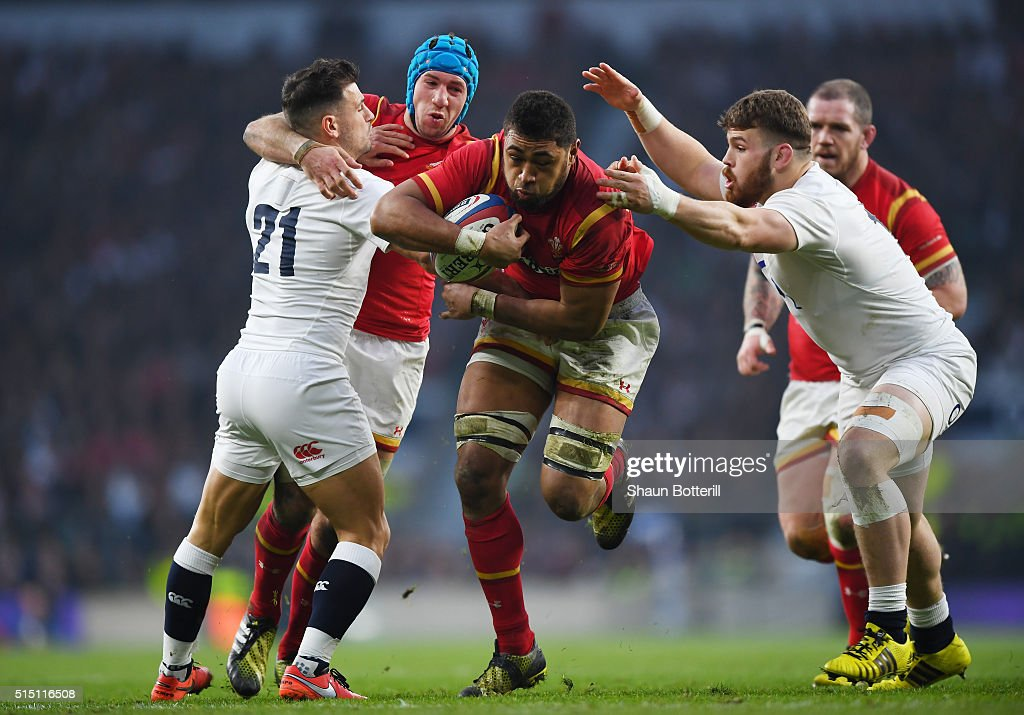 Taulupe Faletau of Wales evades a tackle from Luke Cowan-Dickie (R) of England on the way to scoring his try during the RBS Six Nations match between England and Wales at Twickenham Stadium on March 12, 2016 in London, England.