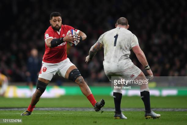 Taulupe Faletau of Wales is challenged by Joe Marler of England during the 2020 Guinness Six Nations match between England and Wales at Twickenham...