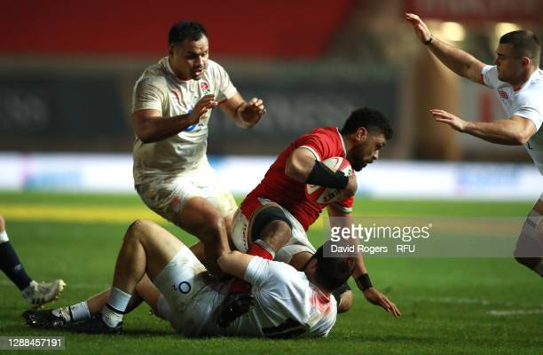 Taulupe Faletau of Wales is held by Luke Cowan-Dickie during the Quilter International match between Wales and England as part of the Autumn Nations...