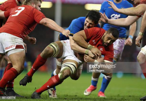 Taulupe Faletau of Wales is tackeld during the NatWest Six Nations match between Wales and Italy at the Principality Stadium on March 11 2018 in...
