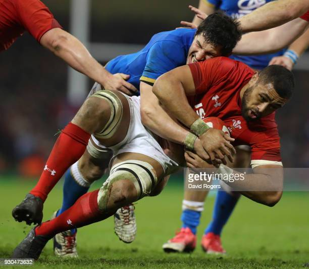 Taulupe Faletau of Wales is tackled by Alessandro Zanni of Italy during the NatWest Six Nations match between Wales and Italy at Principality Stadium...