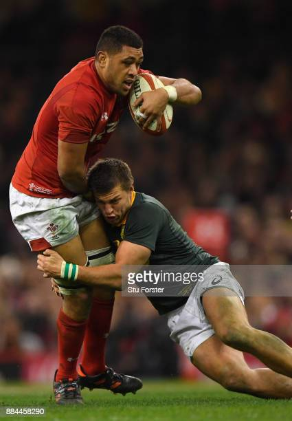 Taulupe Faletau of Wales is tackled by Handre Pollard during the International between Wales and South Africa at at Principality Stadium on December...