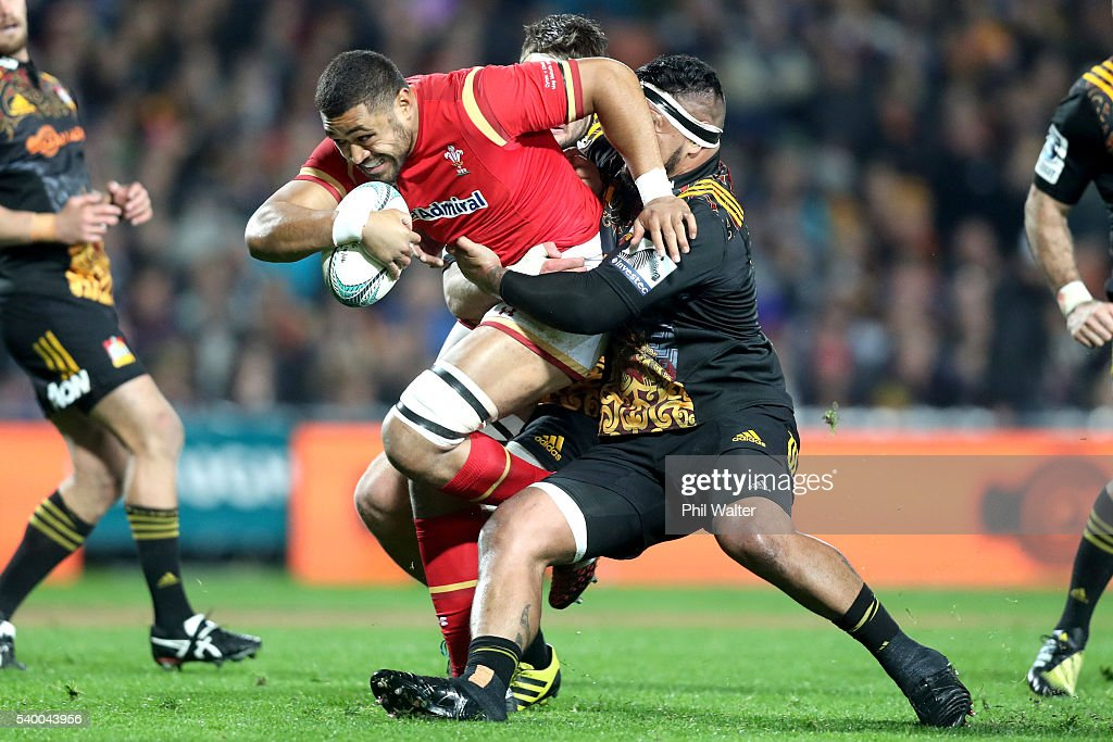 Taulupe Faletau of Wales is tackled by Hika Elliot of the Chiefs during the International Test match between the Chiefs and Wales at Waikato Stadium on June 14, 2016 in Hamilton, New Zealand.