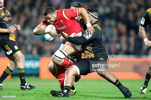 Taulupe Faletau of Wales is tackled by Hika Elliot of the Chiefs during the International Test match between the Chiefs and Wales at Waikato Stadium...