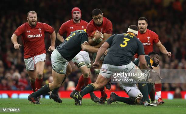 Taulupe Faletau of Wales is tackled by Malcolm Marx and Wilco Louw during the rugby union international match between Wales and South Africa at the...