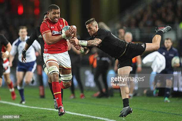 Taulupe Faletau of Wales is tackled by TJ Perenara of the All Blacks during the International Test match between the New Zealand All Blacks and Wales...